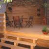 März 06 - Wollen Sie kein Tropenholz? Holzdeck mit Wandeelement, Sitzbank und Treppe in Eiche.