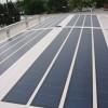 August 08 - Photovoltaikanlage in der Flachdachabdichtung auf einem Bungalow